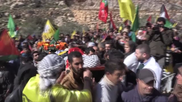 Palestinians carry body of a Palestinian youth during his funeral in the village of Mugheer about 25 kilometres northeast of the city of Ramallah...