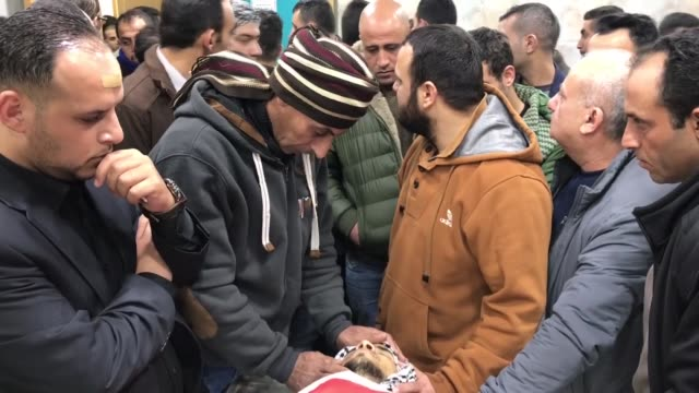 Palestinians carry dead body of Palestinian Mohammad Amin Akel who was allegedly attempted a stabbing attack and killed by Israeli soldiers on...