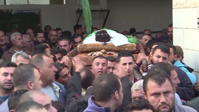 Palestinians carry the body of Nawaf al Aatar during his funeral procession in Beit Lahia after he was killed by Israeli fire in the border area of...