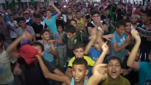 palestinians celebrate the ceasefire between palestinian resistance factions and israel in rafah, khan yunis and nablus cities on august 26, 2014. an... - ceasefire stock videos & royalty-free footage