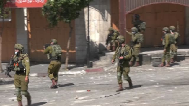 palestinians clash with israeli army during a demonstration in the west bank city of hebron against israel's west bank annexation plan - israel palestine conflict stock videos & royalty-free footage