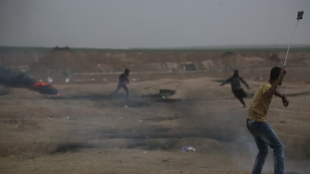palestinians clash with israeli forces in response to israeli soldiers' intervention as part of the great march of return demonstration in gaza on... - gaza strip stock videos & royalty-free footage