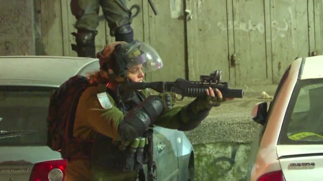 palestinians clash with israeli security forces during a raid in the west bank city of ramallah - west bank stock videos & royalty-free footage