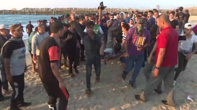 Palestinians clash with Israeli security forces following a protest calling for an end to the Israeli blockade on Gaza on a beach in Beit Lahia near...