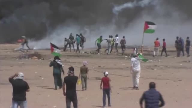 """palestinians continue to rally as part of the """"great march of return"""" near the gazaisrael border on may 11 2018 in gaza city palestinians hold... - gaza strip stock videos & royalty-free footage"""