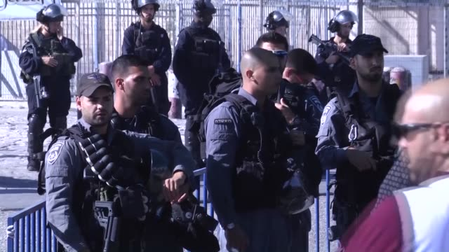 palestinians cross the qalandia checkpoint on their way to the al-aqsa mosque, in the old city of jerusalem to attend the third friday prayer of the... - friday stock videos & royalty-free footage