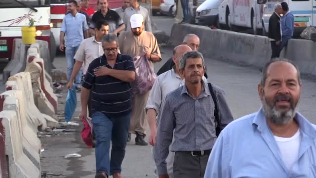 Palestinians cross the Qalandiya checkpoint between the West Bank city of Ramallah and Jerusalem on their way to pray at the AlAqsa Mosque in...