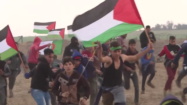 palestinians evacuate injured protesters and throw stones using slingshots during protest along the border with israel east of gaza city - catapult stock videos & royalty-free footage