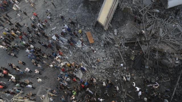 palestinians gather around a building after it was bombed by an israeli aircraft in gaza city august 9 2018 - bomb stock videos & royalty-free footage