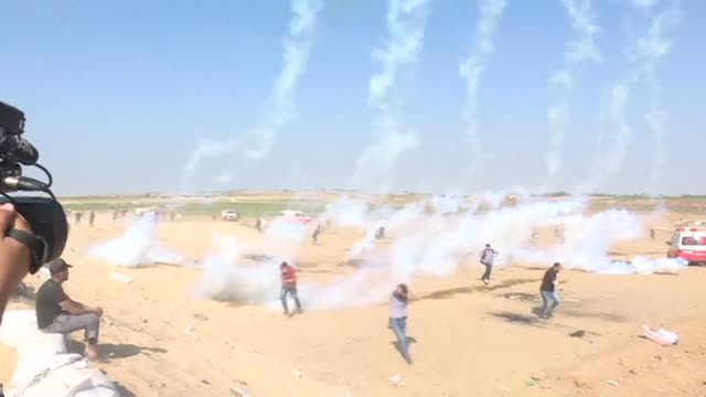 palestinians gather for protests on the palestinian side of the gaza israel border burning tyres as smoke billows into the sky and the spokesman for... - israeli military stock videos & royalty-free footage