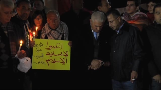 palestinians gather in front of the house of jordan's ambassador to palestine khaled shawabkeh to stage a protest after a video was published... - isis execution stock videos & royalty-free footage