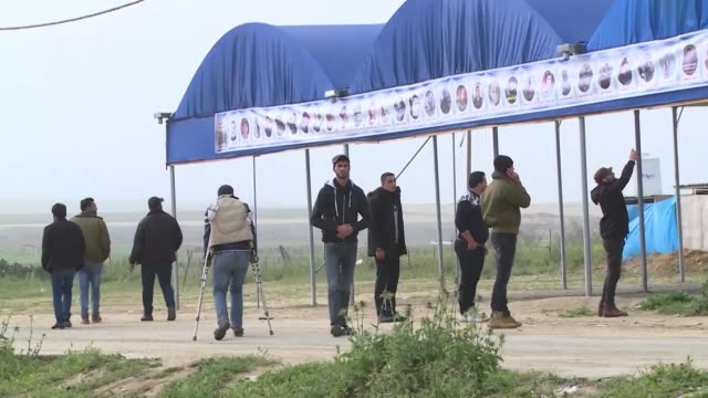 palestinians gather near the israeli border in gaza to mark the first anniversary of the march of return protests - gaza strip stock videos & royalty-free footage
