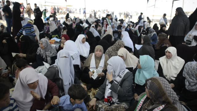 Palestinians gather to protest near the Israeli border fence east of Gaza City in the central Gaza Strip on April 13 2018 Several thousand Gazans...