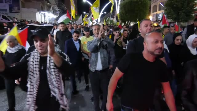 palestinians gathered in the occupied west bank city of hebron early saturday , protesting israel's attacks in jerusalem and gaza. israeli forces... - hebron west bank stock videos & royalty-free footage