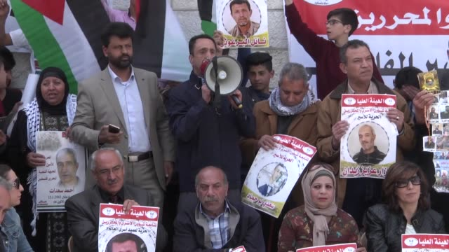 palestinians held a demonstration to support palestinians prisoners in israeli prisons in front of international red cross building in ramallah west... - ramallah stock videos and b-roll footage