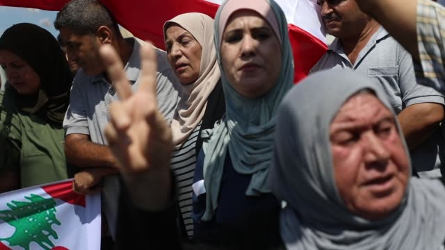 palestinians hold palestinian and lebanese flags in gaza city august 6 in support of lebanon after two days a blast in a warehouse in the port of the... - destruction stock videos & royalty-free footage