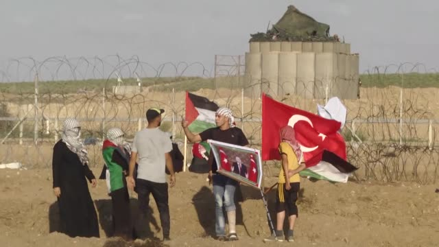 palestinians hold turkish flags and portraits of turkish president recep tayyip erdogan as hundreds of palestinians converged along the gazaisrael... - gaza city stock videos & royalty-free footage