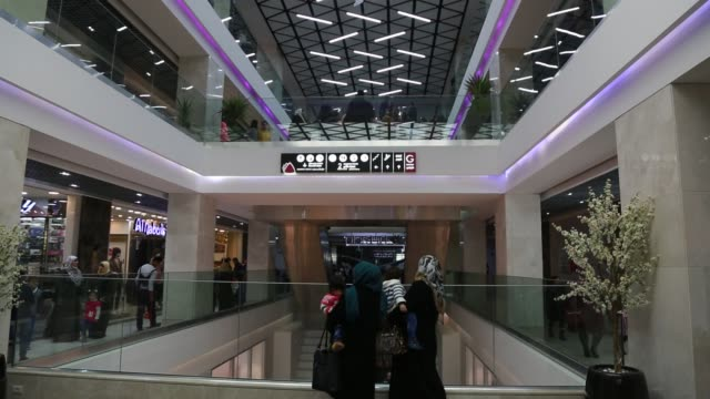 palestinians in a new indoor shopping mall in the gaza strip, in gaza city on february 23, 2017. in a welcome sign of normalcy, the first-of-its-kind... - 800 meter stock videos & royalty-free footage