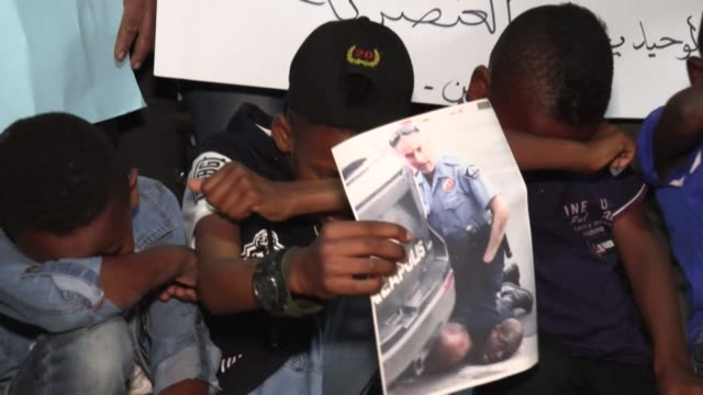 palestinians in gaza hold a sit-in to show their support for george floyd, with some children kneeling while holding a portrait of the black man who... - israel stock videos & royalty-free footage