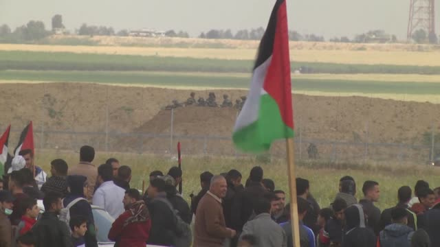 palestinians injured by israeli army gunfire on march 30 2018 near the gaza strip's eastern border with israel are carried by other protesters during... - historical palestine stock videos & royalty-free footage
