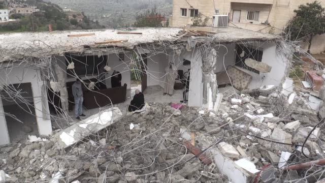 palestinians inspect a house demolished by israeli occupation forces in al walaja village of bethlehem, west bank on february 11, 2019. palestinian... - media occupation stock videos & royalty-free footage