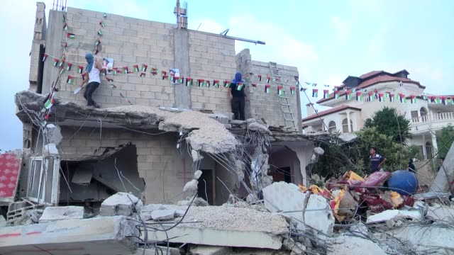 Palestinians inspect the remains of the family house of Omar AlAbed after it was demolished by Israeli authorities in the West Bank village of Kobar...