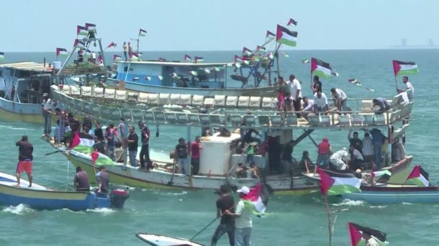 palestinians launch boats from the seaport in gaza city to protest israel's sea blockade of the coastal enclave - gaza city stock videos & royalty-free footage