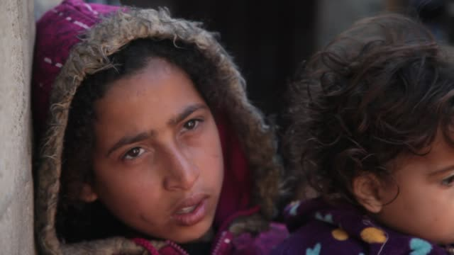 palestinians living in a poor slum areas suffering a lack of shelter in gaza palestine on march 16 2017 - palestine girl stock videos and b-roll footage