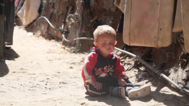 palestinians living in a poor slum areas suffering a lack of shelter in gaza palestine on march 16 2017 - only boys stock videos and b-roll footage