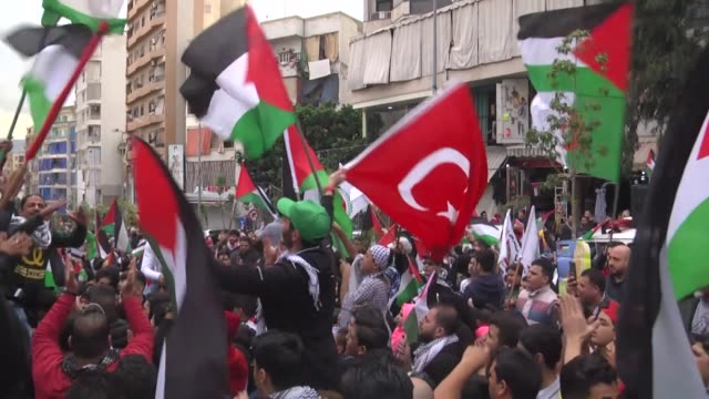 palestinians living in lebanon stage a demonstration following the friday prayer at imam ali mosque to protest us president donald trump's... - shrine of the imam ali ibn abi talib stock videos & royalty-free footage