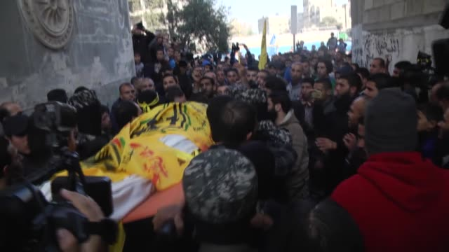 Palestinians mourn over the death of Musa Zuayter who was killed in an Israeli air strike on Beit Lahia during his funeral at the Jabalia refugee...