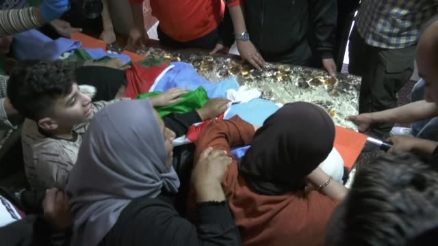 palestinians mourn the death of 15yearold zaid qaysia during his funeral at the alfawar refugee camp south the west bank town of hebron - refugee camp stock videos & royalty-free footage