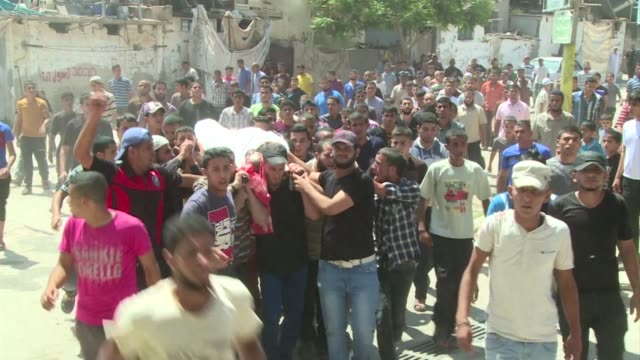 vídeos de stock e filmes b-roll de palestinians mourned on friday four people killed by israeli air strikes two of them were killed in a strike on nusseirat refugee camp and the two... - air raid