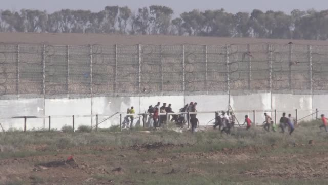 palestinians on friday converged near a fence that separates gaza strip from israel to demonstrate against israel's decades-long occupation of... - historical palestine stock videos & royalty-free footage