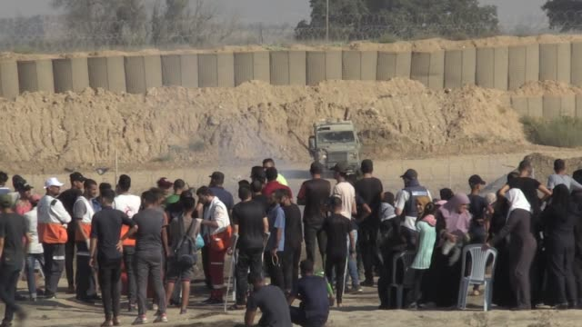 palestinians on friday converged near a security fence that separates gaza strip from israel to demonstrate against israel's decades-long occupation... - gaza strip stock videos & royalty-free footage