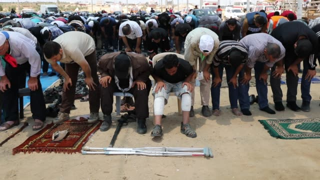 palestinians participate in friday prayer near the border fence with israel as mass demonstrations at the fence continue on may 11 2018 in gaza city... - 2018 gaza border protests stock videos & royalty-free footage
