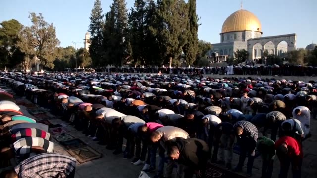 Palestinians performed early morning prayers at the Al Aqsa Mosque compound in Jerusalems Old City on the first day of Eid Al Fitr
