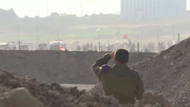 palestinians protest along the gaza strip's border with israel with israeli forces firing tear gases and palestinians attaching molotov cocktails to... - gaza strip stock videos & royalty-free footage