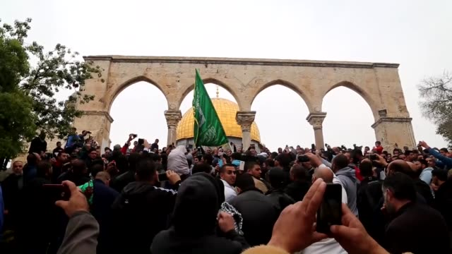 Palestinians protest Israel and shout antiIsrael slogans after performing friday prayer in AlAqsa Mosque in Jerusalem on 19 December 2014...