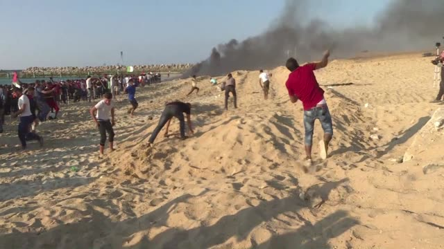 Palestinians protest to demand the lift of the Israeli blockade on Gaza on a beach in Beit Lahia near the maritime border with Israel where clashes...