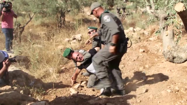 stockvideo's en b-roll-footage met palestinians protested again on wednesday in the occupied west bank village of beit jala against the building of israels controversial separation... - oost jeruzalem