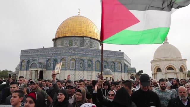 palestinians protested in jerusalem's al aqsa mosque compound after midday prayers friday as part of continued palestinian demonstration against us... - midday stock videos and b-roll footage