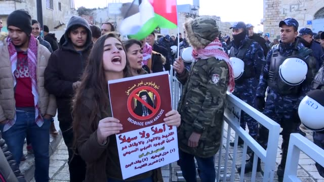 Palestinians protesting church land sales to Israelis scuffle with Palestinian police in Bethlehem as they try to block the arrival of the Holy...