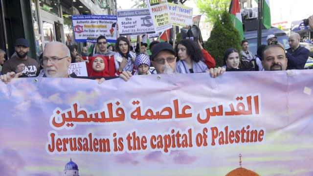 palestinians rally and march in bay ridge brooklyn new york city a predominantly palestinian and arab community in solidarity with the palestinians... - palestinian flag stock videos & royalty-free footage