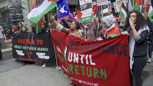 palestinians rally and waved palestinian flags in manhattan's times square proceeded by a march to the consulate general of israel – adults and high... - west bank stock videos & royalty-free footage