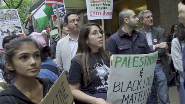 Palestinians rally and waved Palestinian flags in Manhattan's Times Square proceeded by a march to the Consulate General of Israel – adults and high...