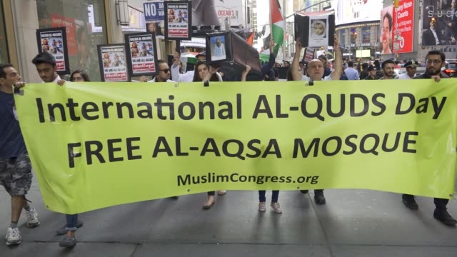 Palestinians rally and waved Palestinian flags in Manhattan's Times Square on Quds Day proceeded by a march to the Consulate General of Israel in...