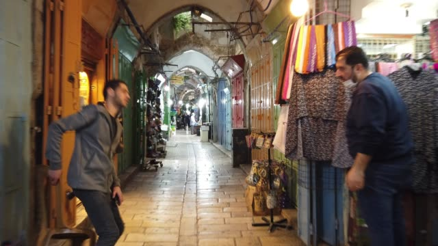 palestinians shop at the market bazaar in the old city may 10 2020 in jerusalem israel outdoor markets and malls opened in israel on thursday after... - middle east stock videos & royalty-free footage