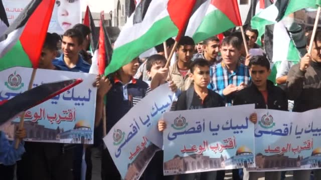 palestinians shout slogans as they march during a rally to condemn the violations and occupation of alaqsa mosque and israeli restrictions on the... - al aqsa mosque stock videos and b-roll footage