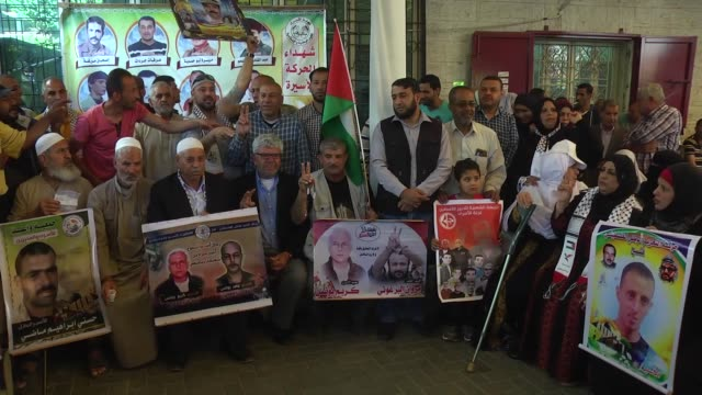 palestinians stage a demonstration in solidarity with israeliheld palestinian prisoners who are on hunger strike to protest their prison conditions... - prisoner icon stock videos & royalty-free footage